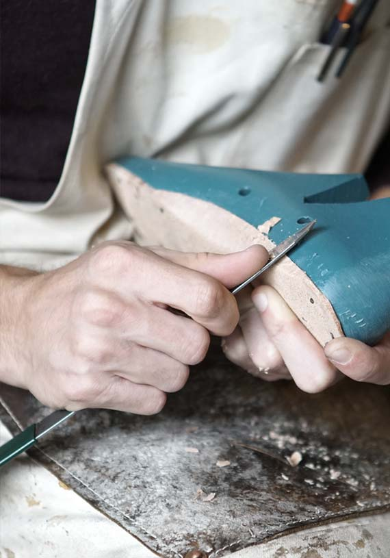 artisan working on made in Italy shoes